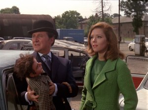Steed and Emma investigate in this episode (image from http://www.dissolute.com.au/the-avengers-tv-series/series-5/519-the-l50000-breakfast.html)